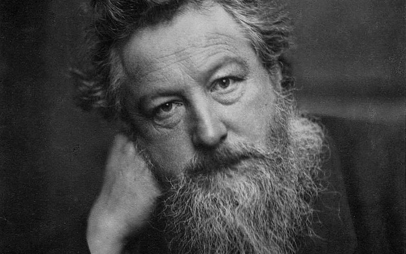 A black and white picture of William Morris looking into the camera.