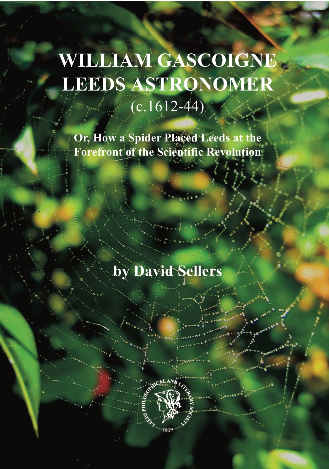 A picture of the book cover featuring a leafy background and a spiders web