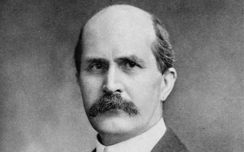 A black and white portrait of William Henry Bragg Nobel looking towards the camera.