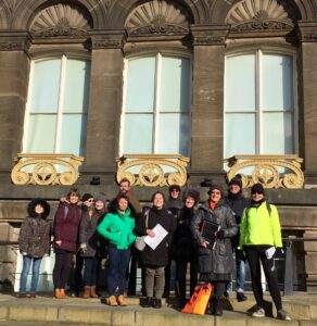 Tour guide Rachael Unsworth + group outside Leeds Museum